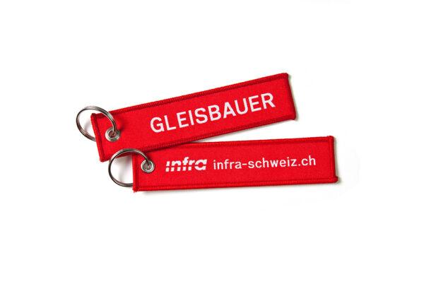 Def_Infra_Schluesselanhaenger_Gleisbauer_Weiss_D_RGB_highres