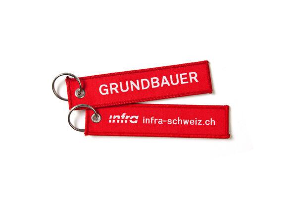 Def_Infra_Schluesselanhaenger_Grundbauer_Weiss_D_RGB_highres