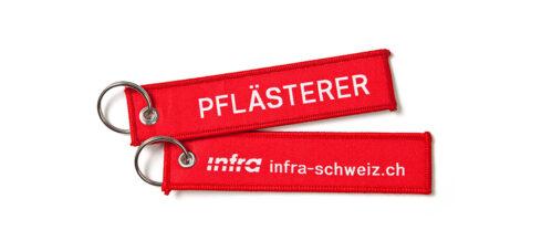 Def_Infra_Schluesselanhaenger_Pflaesterer_Weiss_D_RGB_highres