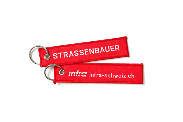Def_Infra_Schluesselanhaenger_Strassenbauer_Weiss_D_RGB_highres